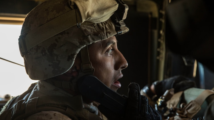 """Staff Sgt. Absalon A. Cabrera uses a radio to communicate with the 4th Marine Regiment's combat operations center while transporting the commanding officer across the battle space Feb. 12 at Marine Air Ground Combat Center Twentynine Palms, California, during the battalion assault course as part of Integrated Training Exercise 2-15. """"I am very proud of all of my Marines,"""" said Cabrera. """"They have accomplished a lot and it has been seen at different levels out here."""" ITX 2-15 is designed to integrate combined arms and improve war fighting capabilities. Cabrera, a Los Angeles, California, native and an infantry unit leader, is the jump team commander for Special Purpose Marine Air-Ground Task Force Four with Headquarters Company, 4th Marine Regiment, 3rd Marine Division, III Marine Expeditionary Force."""