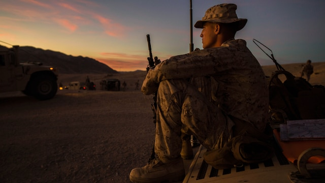 """Lance Cpl. Bradley W. Walsh finally gets to relax after a long day of traveling across the rough terrain of the Mojave desert Feb. 12 at Marine Air Ground Combat Center Twentynine Palms, California, during Integrated Training Exercise 2-15. Walsh leads fellow junior Marines during ITX 2-15 as the assistant convoy commander for the jump team. """"It's awesome to get all the responsibility thrown on you,"""" said Walsh. ITX 2-15 is designed to integrate combined arms and improve war fighting capabilities. Walsh, a Granville, Ohio, native, and rifleman, is with Headquarters Company, 4th Marine Regiment, 3rd Marine Division, III Marine Expeditionary Force."""