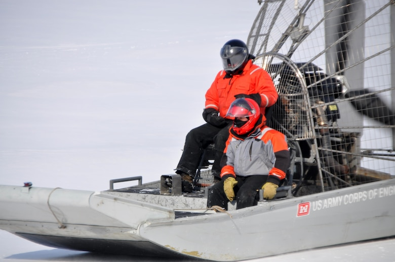 Airboat operator Bill Chelmowski and survey technician Kurt Schroeder scoot across frozen Lake Pepin as ice thickness measurements are taken on Feb. 18, 2015. St. Paul District staff from the channels and harbors section took to the ice of Lake Pepin on Feb. 18 for the first of weekly ice thickness measurements. The thickest ice discovered this year was at river miles 771 and 766, where 21 inches were recorded.