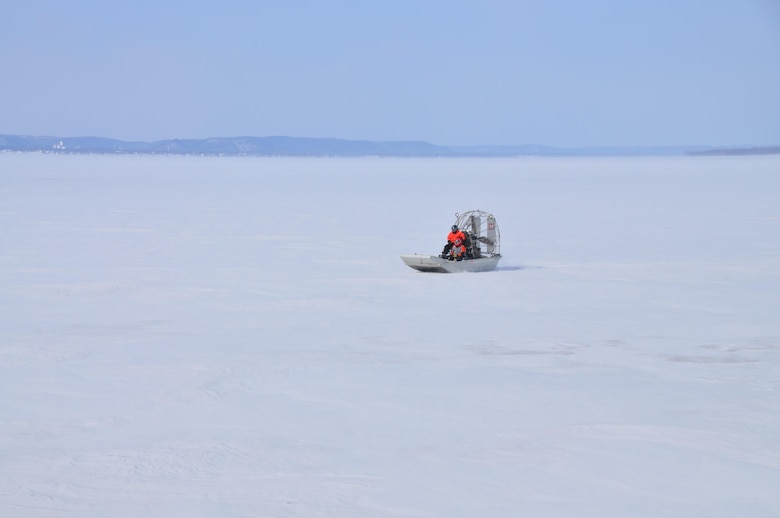 Airboat operator Bill Chelmowski and survey technician Kurt Schroeder scoot across frozen Lake Pepin as ice thickness measurements are taken on Feb. 18, 2015. St. Paul District staff from the channels and harbors section took to the ice of Lake Pepin on Feb. 18, for the first of weekly ice thickness measurements. The thickest ice discovered this year was at river miles 771 and 766, where 21 inches were recorded.