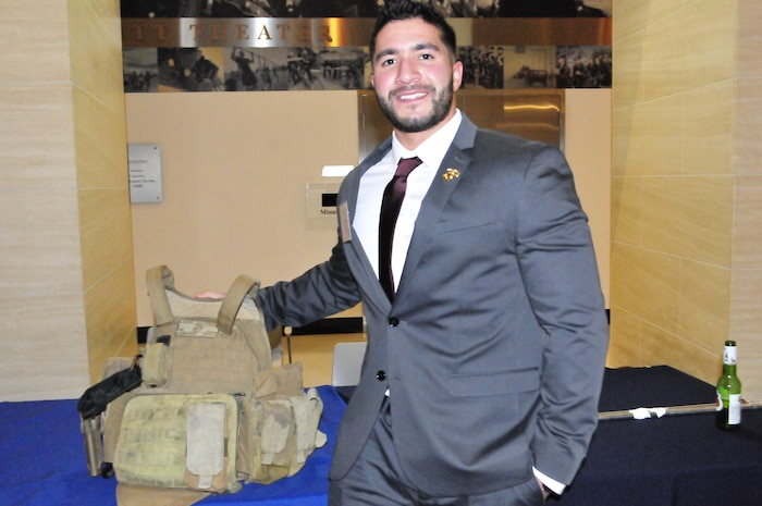 Sgt. Luis Hernandez was serving in Marjah, Afghanistan with the 1st Battalion, 6th Marine Regiment when an IED exploded and nearly killed. He donated the flak jacket he was wearing at the time to the National Museum of the Marine Corps during Friday night's Marjah Marines Reunion Dinner at the National Museum of the Marine Corps.
