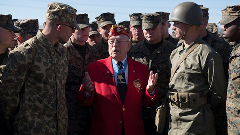 "Marines from the Marine Artillery Detachment at Fort Sill, Oklahoma gather around Marine veteran and Medal of Honor recipient Hershel ""Woody"" Williams after a ceremony held to honor Iwo Jima veterans and their service February 19, 2015. Williams is the last surviving veteran who was awarded the Medal of Honor for his actions during the battle for Iwo Jima."