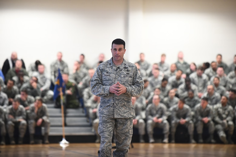 Col. John Wagner, 460th Space Wing commander, addresses Team Buckley members at the first commander's call of the year Feb. 19, 2015, at Buckley Air Force Base, Colo. The commander's call outlined the challenges facing the Air Force today and what needs to be done to improve upon current operating procedures. (U.S. Air Force photo by Airman 1st Class Luke W. Nowakowski/Released)