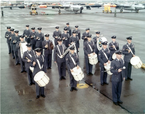 Members of the Oregon ANG (OreANG) Drum & Bugle Corps enjoy a moment in the sun as they stand ready on the ramp at Portland AFB in this early view of the corps, circa late 1960. Note the OreANG's Northrop F-89J Scorpion fighter-interceptors in the background.