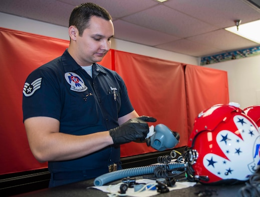Staff Sgt. Jose Ibarra, U.S. Air Force Air Demonstration Squadron flight equipment specialist, conducts a 30-day breakdown inspection of helmets and oxygen masks at the Thunderbirds Hangar on Nellis Air Force Base, Nev., Feb. 9, 2015. The Thunderbirds squadron is an Air Combat Command unit composed of eight pilots, including six demonstration pilots, four support officers, three civilians and more than 130 enlisted personnel performing in 25 career fields. (U.S. Air Force photo by Staff Sgt. Kristina Overton)