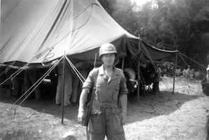 1951 Photo of Unknown individual in front of Operations Tent.  Kaufman is the name written on this photo but his name does not appear on the 118th ACW Activation Order.  He is probably an Active Duty member assigned to the 118th for this deployment.  This a bivouac location at Cedars of Lebanon State Park, Lebanon, Tennessee in June 1951 while deployed to Seward AFB, Tennessee in late 1951.  The 118th ACW Sq was further deployed to Nouasseur AB, French Morocco, North Africa on Christmas Eve 1951 in support of the Korean War effort. (Photo by NCANG Heritage Program)