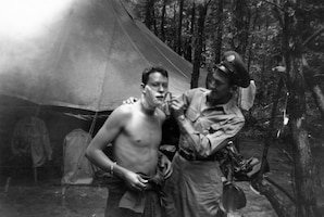 1951 bivouac to Cedars of Lebanon State Park, Lebanon, Tennessee; Troy Brotherton is shaving Unknown individual. (Photo by NCANG Heritage Program)
