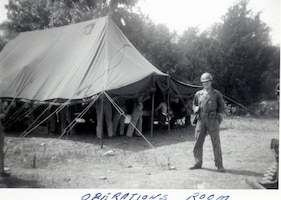 1951 Photo of Unk Individual in front of Operations Tent.  This a bivouac location at   Cedars of Lebanon State Park, Lebanon, Tennessee in June 1951 while deployed to Seward AFB, Tennessee in late 1951.  The 118th ACW Sq was further deployed to Nouasseur AB, French Morocco, North Africa on Christmas Eve 1951 in support of the Korean War effort. (Photo by NCANG Heritage Program)
