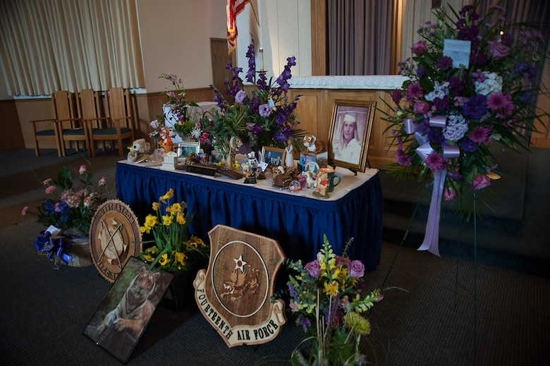 """Tiger-themed mementos which adorned her desk are displayed at a memorial service for Tammy Martin, 14th Air Force Commander's Secretary, at the base chapel, Feb. 19, 2015.  A 40-year civil servant, """"Ms. Tammy,"""" as she was known, passed away Feb. 12, 2015 following a sudden illness. More than 200 friends, family members and members of her extended Air Force family were on hand to celebrate her life.  (U.S. Air Force photo by Michael Peterson/Released)"""