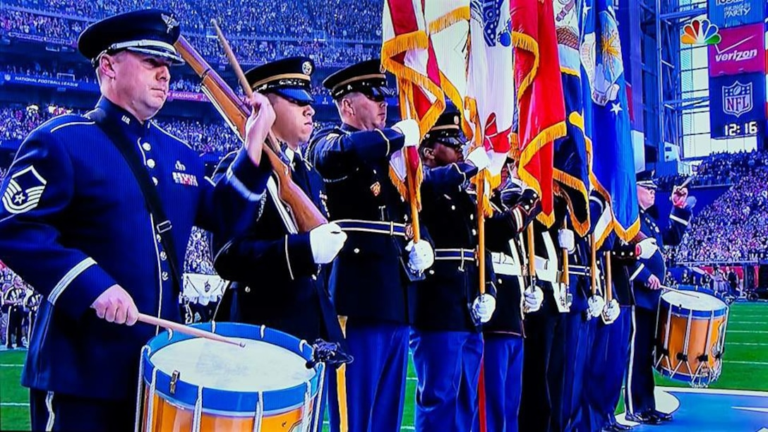 Ceremonial Brass drummers Master Sergeant Tom Rarick and Senior Master Sergeant Chris Martin, along with the Joint Service Honor Guard, got some great screen time during their performance at the opening ceremonies for Super Bowl XLIX. (U.S. Air Force photo/released)