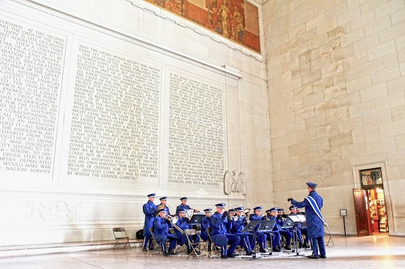 The United States Air Force Band Ceremonial Brass participated in a wreath laying ceremony at the Lincoln Memorial.  The ceremony was in honor of former President Lincoln's 206th birthday. (U.S. Air Force Photo by Technical Sergeant Christine Purdue/released)
