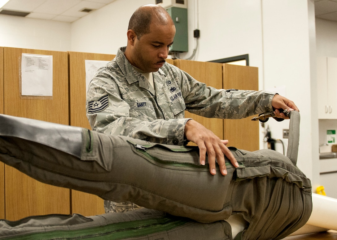 Tech Sgt. Elijah Gantt, of the 96th Operations Support Squadron, conducts a leakage test on a CSU-22 anti-gravity suit at the Aircrew Flight Equipment facility on Eglin Air Force Base, Fla., Feb. 9.  The maintenance of the anti-gravity suits is critical to the pilot's performance and safety.  The anti-gravity suits increase a pilot's mental capacity and allows them to pull more G-forces without losing consciousness.  (U.S. Air Force photo/Ilka Cole)