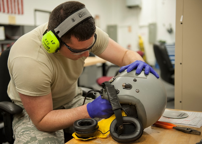 Staff Sgt. Steven Runion, of the 96th Operations Support Squadron, drills down the screws on the interior side of a fighter helmet at the Aircrew Flight Equipment facility on Eglin Air Force Base, Fla., Feb. 9. AFE technicians trim down any protruding screws to ensure no damage is done to the combat edge bladder.  The maintenance of the helmets is critical to the pilot's performance and safety.  The bladder on the interior of the helmets is designed to improve tolerance to high-G maneuvers and help prevent G-induced loss of consciousness.  (U.S. Air Force photo/Ilka Cole)