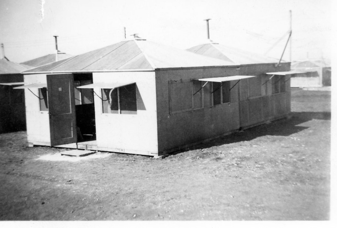 """""""Dallas Hut"""" built by 118th ACW Sq in 1952.  The 118th ACW was deployed to North Africa to 3 locations in support of the Korean War effort.  This location as at Nouasseur AB, North Africa.  Two huts tied together could sleep up to four people per hut and heated by """"Pot Belly"""" stove in center of hut. (Photo by NCANG Heritage Program)"""