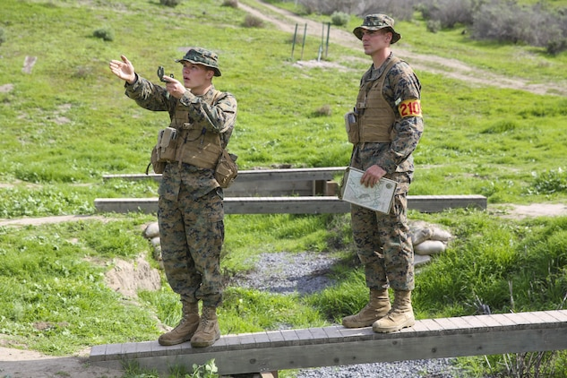 Recruits Jacob R. Kottman and Chainey L. Ellis, (right to left) Platoon 2105, Echo Company, 2nd Recruit Training Battalion, confirm they're going the correct direction during the Land Navigation Course at Edson Range, Marine Corps Base Camp Pendleton, Calif., Jan. 22.  Recruits will use these skills taught when they continue their training at the School of Infantry.