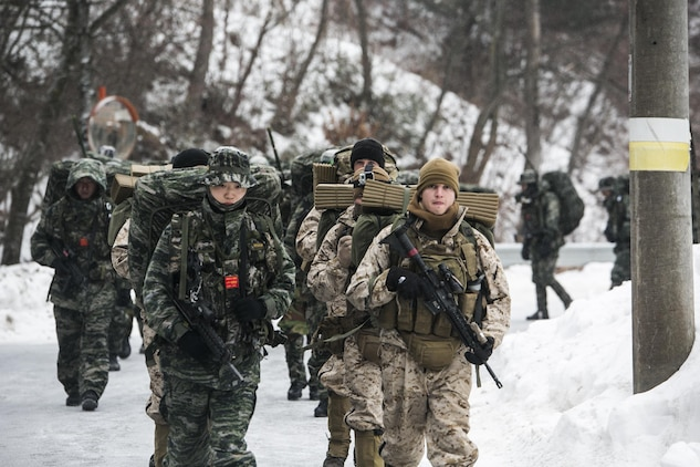 U.S. and Republic of Korea Marines hike a 35- km path up a mountain Jan. 15 during Korean Marine Exchange Program 15-3 in Pyeongchang, Republic of Korea. The U.S. Marines hiked side-by-side with their ROK Marine counterparts through snow and ice. The U.S. Marines are reconnaissance men with Alpha Company, 3rd Reconnaissance Battalion, 3rd Marine Division, III Marine Expeditionary Force. The ROK Marines are force reconnaissance men with 2nd Battalion, 2nd Marine Division.