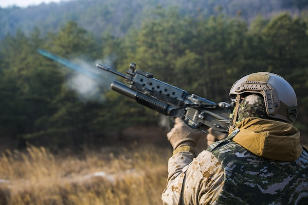 U.S. Marine Cpl. Richard J. Bennaugh fires training rounds from a Daewoo K201 grenade launcher Feb. 5 during Korean Marine Exchange Program 15-3 at Gimpo, Republic of Korea. The U.S. Marines fired six training rounds and then watched a live fire shoot demonstrated by Republic of Korea Marines. The U.S. Marines were given the unique opportunity to also test out the Daewoo K1 submachine gun, Daewoo K5 handgun, the Daewoo K2 assault rifle and the Daewoo K14 sniper rifle. Bennaugh, from Pittsburgh, Pennsylvania, is a reconnaissance man with Alpha Company, 3rd Reconnaissance Battalion, 3rd Marine Division, III Marine Expeditionary Force.