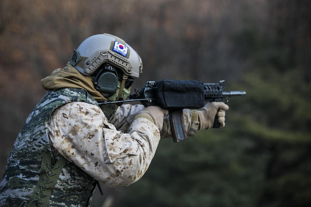 U.S. Marine Cpl. Richard J. Bennaugh fires rounds from a Daewoo K1 submachine gun Feb. 5 during Korean Marine Exchange Program 15-3 at Gimpo, Republic of Korea. The U.S. Marines were given the unique opportunity to also test out the Daewoo K2 assault rifle, Daewoo K5 handgun, the K201 40mm grenade launcher and the Daewoo K14 sniper rifle. Bennaugh, from Pittsburgh, Pennsylvania, is a reconnaissance man with Alpha Company, 3rd Reconnaissance Battalion, 3rd Marine Division, III Marine Expeditionary Force.
