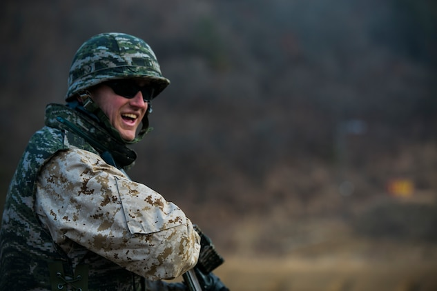 U.S. Marine Cpl. Peyton N. Whitted beams with joy after successfully knocking down targets Feb. 5 during Korean Marine Exchange Program 15-3 at Gimpo, Republic of Korea. The U.S. Marines were given the unique opportunity to test out the Daewoo K1 submachine gun, Daewoo K2 assault rifle, Daewoo K5 handgun, the K201 40mm grenade launcher, the Daewoo K14 sniper rifle, and the Type 58 assault rifle. Whitted is a reconnaissance man with Alpha Company, 3rd Reconnaissance Battalion, 3rd Marine Division, III Marine Expeditionary Force.