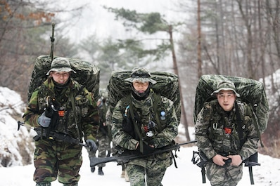 Republic of Korea Marines hike a 35- km path up a mountain Jan. 15 during Korean Marine Exchange Program 15-3 in Pyeongchang, Republic of Korea. The ROK Marines were training for mountain warfare and snow mobility warfare alongside their U.S. counterparts from Alpha Company, 3rd Reconnaissance Battalion, 3rd Marine Division, III Marine Expeditionary Force. The ROK Marines are force reconnaissance men with 2nd Battalion, 2nd Marine Division.