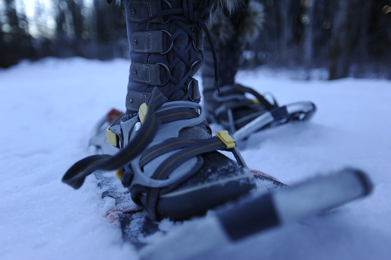 A park visitor learns to walk in snowshoes through Denali National Park, Alaska, Jan. 19, 2015. Snowshoes are an invaluable tool that helps spread out the weight of an individual, allowing them to walk on top of snow. Denali National Park owns dozens of pairs of snowshoes that are free to rent for park visitors. (U.S. Air Force photo by 1st Lt. Elias Zani/Released)