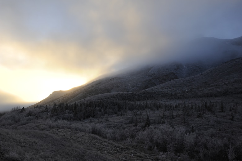 The sunrise is seen through the fog in Denali National Park, Alaska, Jan. 19, 2015. Denali National Park is one of 23 national parks in Alaska and is open year round for visitors. (U.S. Air Force photo by 1st Lt. Elias Zani/Released)