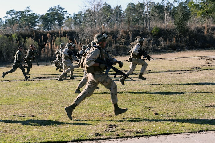 Marines with 2nd Combat Engineer Battalion, 2nd Marine Division, run to a firing point at a range here, Feb. 10, 2015. Critical Skills Operators with 3rd Marine Special Operations Battalion, U.S. Marine Corps Forces Special Operations Command, trained with 2nd CEB Marines during RAVEN 15-03, a 10-day realistic military training exercise to enhance the battalion's readiness for worldwide support to global security. Marines with 2nd CEB played the role of a partner nation force during the exercise. (Official U.S. Marine Corps photo by GySgt. Josh Higgins/released)