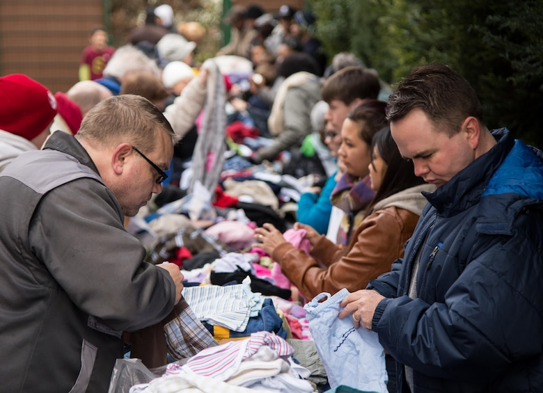 Maj. Matthew Boyd, right, arranges donated clothing Feb. 21, 2015, in Kaiserslautern, Germany. Boyd continues his family's tradition of serving in the military, working as a chaplain and offering guidance to those in need. Boyd is the 86th Airlift Wing chaplain. (Courtesy photo)