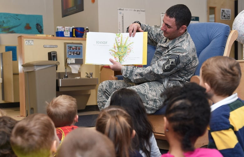 Chief Master Sgt. Brian Kruzelnick, 460th Space Wing command chief, reads to children Feb. 24, 2015, at the A-Basin Child Development Center on Buckley Air Force Base, Colo. The wing leader participated in the reading in honor of Black History Month. (U.S. Air Force photo by Airman 1st Class Samantha Saulsbury/Released)