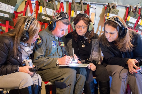 Master Sgt. Ben Brent, 465th Air Refueling Squadron explains the air route to wing spouses during a spouse orientation flight here Feb. 7.  This flight was one of the first spouse flights the wing hosted in many years.  (Courtesy Photo/Gayle Robbins)