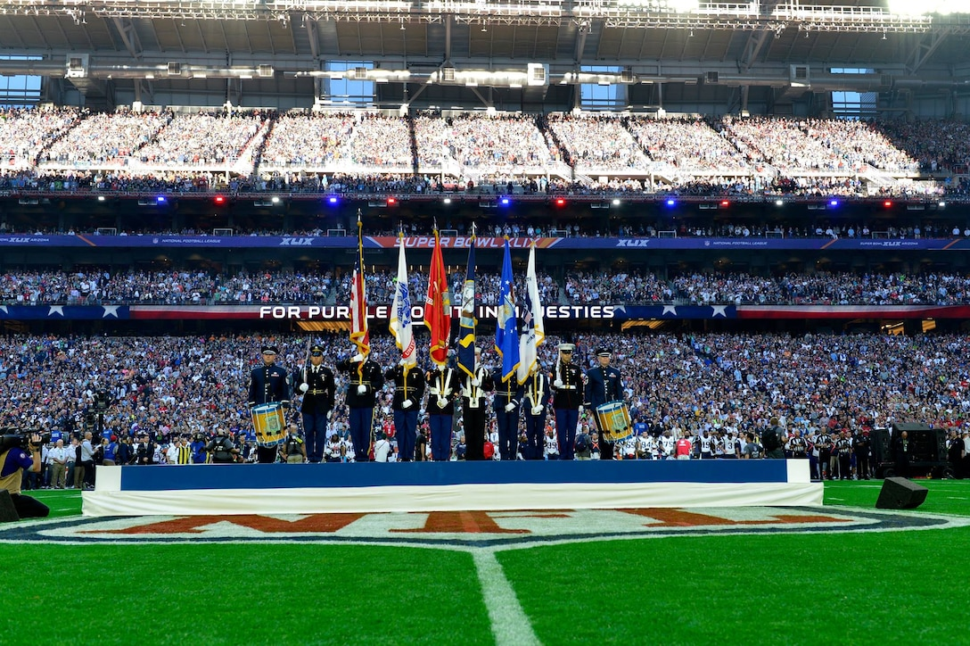 Rope drummers, Senior Master Sgt. Chris Martin and Master Sgt. Tom Rarick, from the Ceremonial Brass were a part of the joint color guard at this year's Super Bowl. Several Airman musicians from The U. S. Air Force Band had the unique opportunity to participate in a complex, integrated outreach and engagement plan managed by the Secretary of the Air Force Office of Public Affairs in association with the NFL's 2015 Pro Bowl and Super Bowl activities in Arizona. (U.S. Air Force photo/released)