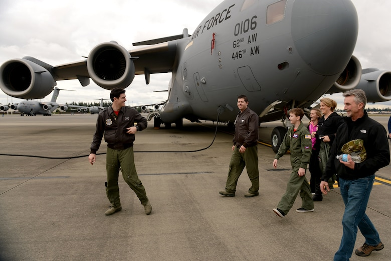 The Faull family receives a tour of a C-17 Globemaster III, Feb. 20, 2015 at Joint Base Lewis-McChord.  Carver Faull (fourth from the right) was honored through the Pilot for a Day Program and received a tour of many of the operations on McChord Field. (U.S. Air Force photo /Staff Sgt. Tim Chacon)