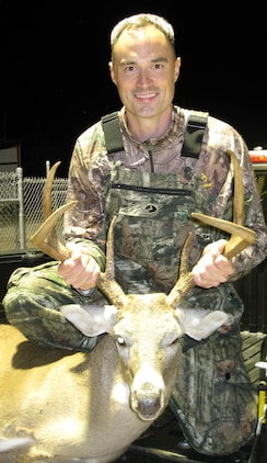 Maj. John Skutch, director, Future Plans Division, Marine Corps Logistics Command, shows off the heaviest buck harvested during Marine Corps Logistics Base Albany's 2014-2015 bow hunting season. Skutch harvested his buck, Oct. 22, 2014, weighing in at 198 pounds.