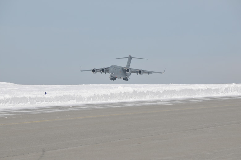 A C-17 Globemaster III from Stewart Air National Guard Base brought about 30 Airmen home to Stratton Air National Guard Base, Scotia, New York, on Feb. 24, 2015. The Airmen were in Antarctica supporting Operation Deep Freeze. More Airmen and LC-130 Hercules ski-equipped aircraft assigned to the 109th Airlift Wing will return throughout the week following the close of the wing's 27th year supporting the National Science Foundation. The season began in October. (U.S. Air National Guard photo by Master Sgt. William Gizara/Released)
