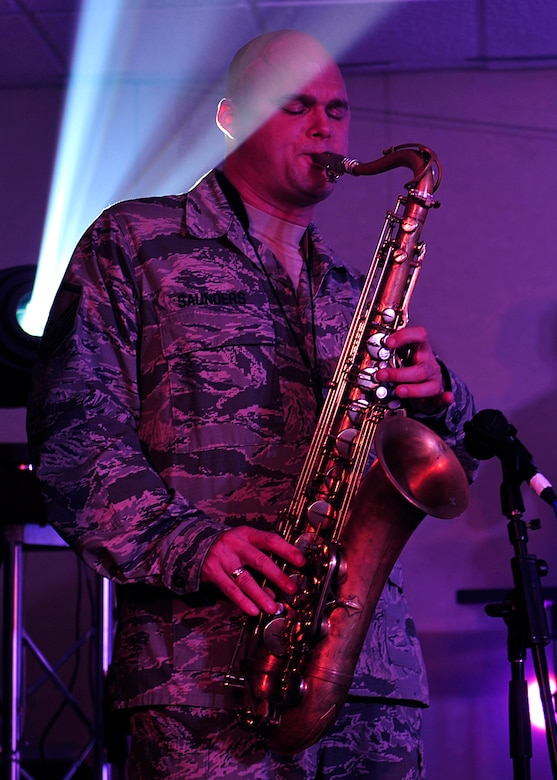 U.S. Air Force Master Sgt. Jeff Saunders, Heritage of America Band Blue Aces, member, plays the saxophone during a musical performance at Langley Air Force Base, Va., Feb. 12, 2015. The Blue Aces perform annually for many military and civilian audiences, in places ranging from small official dinners to large festival events. (U.S. Air Force photo by Airman 1st Class Breonna Veal/Released)