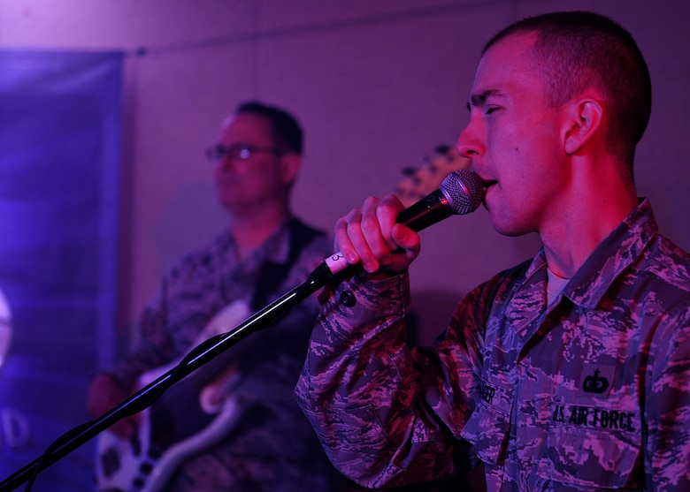 U.S. Air Force Staff Sgt. Ryan Rager, Heritage of America Band Blue Aces, pianist and vocalist, sings during a musical performance at Langley Air Force Base, Va., Feb. 12, 2015. The Blue Aces provide specialized, high-energy performances that feature a wide variety of American popular music styles. (U.S. Air Force photo by Airman 1st Class Breonna Veal/Released)
