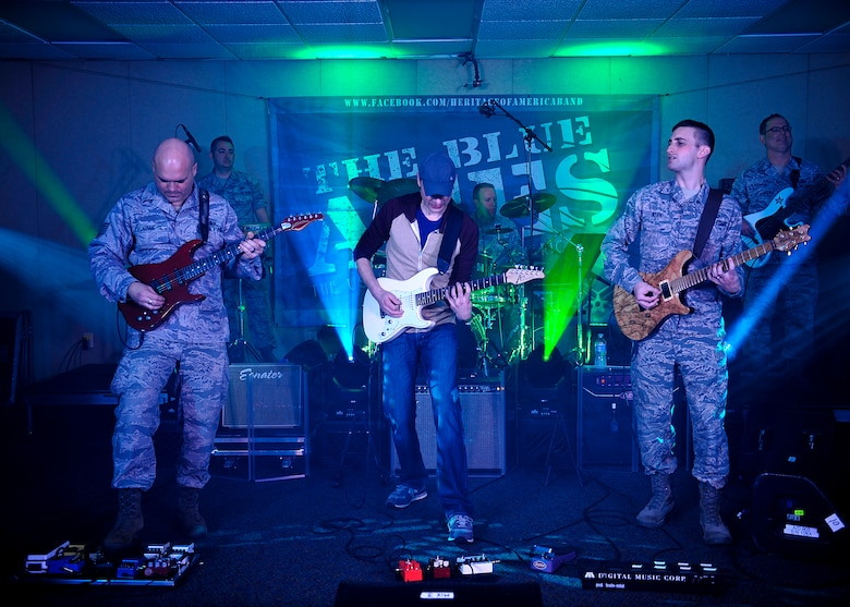 The Blue Aces, a component of the U.S. Air Force Heritage of America Band, perform with Jake Cinninger, Umphrey's McGee's lead guitarist, during a musical performance at Langley Air Force Base, Va., Feb. 12, 2015. Cinninger, an American musician, has been playing musical instruments since he was 3 years old. (U.S. Air Force photo by Airman 1st Class Breonna Veal/Released)