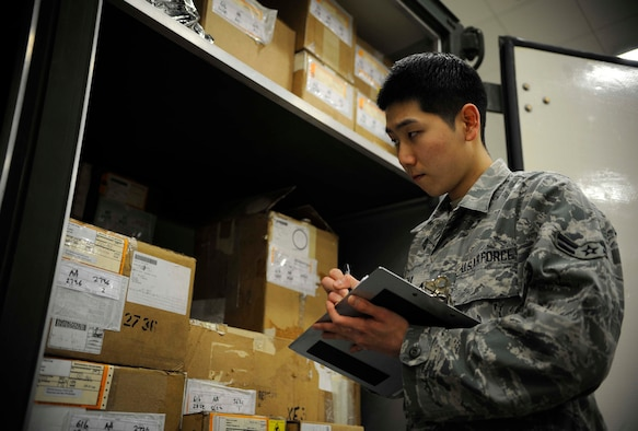 U.S. Air Force Airman 1st Class Christian Pak, materiel management journeyman, checks a serial number on equipment in the aircraft parts store at Misawa Air Base, Japan, Feb. 24, 2015. Pak does this regularly to ensure proper monetary accounting and inventory stock control. (U.S. Air Force photo by Airman 1st Class Jordyn Rucker/Released)