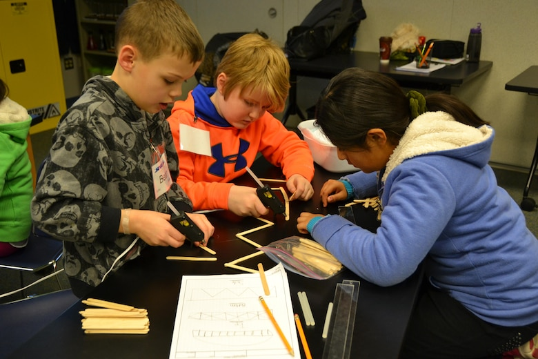WINCHESTER, Va. - The 4th grade members of STARBASE Team Echo eagerly begin construction of their bridge following their carefully drawn out plans.