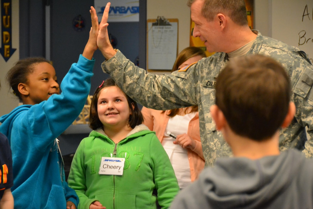 WINCHESTER, Va. - Transatlantic Division Commander Brig. Gen. Robert Carlson high-fives one of the teams after testing their bridge.