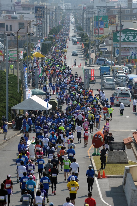 Thousands of runners pass through Kadena Air Base, Japan, Feb. 15, 2015, during the 2015 Okinawa Marathon. A 2.8-kilometer portion of the 42-km race went through Kadena AB. A team of nine municipalities including Kadena AB came together to host the Okinawa Marathon, the only marathon in Japan that runs through a U.S. military installation. (U.S. Air Force photo/Tim Flack)