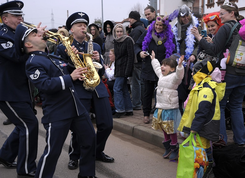 Members of the U.S. Air Forces in Europe Band interact with the crowd during the Fasching parade Feb. 17, 2015, in Ramstein-Miesenbach, Germany. The USAFE Band and approximately 1,400 other participants marched in the parade for more than two hours, entertaining the crowd. (U.S. Air Force photo/Senior Airman Timothy Moore)