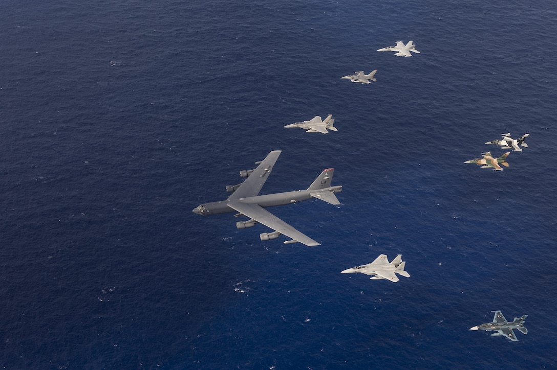U.S. Air Force, Japan Air Self-Defense Force and Royal Australian air force aircraft fly in formation during Cope North 15, Feb. 17, 2015, off the coast of Guam. During the exercise, the U.S., Japan and Australia air forces worked on developing combat capabilities enhancing air superiority, electronic warfare, air interdiction, tactical airlift and aerial refueling. (U.S. Air Force photo/Tech. Sgt. Jason Robertson)