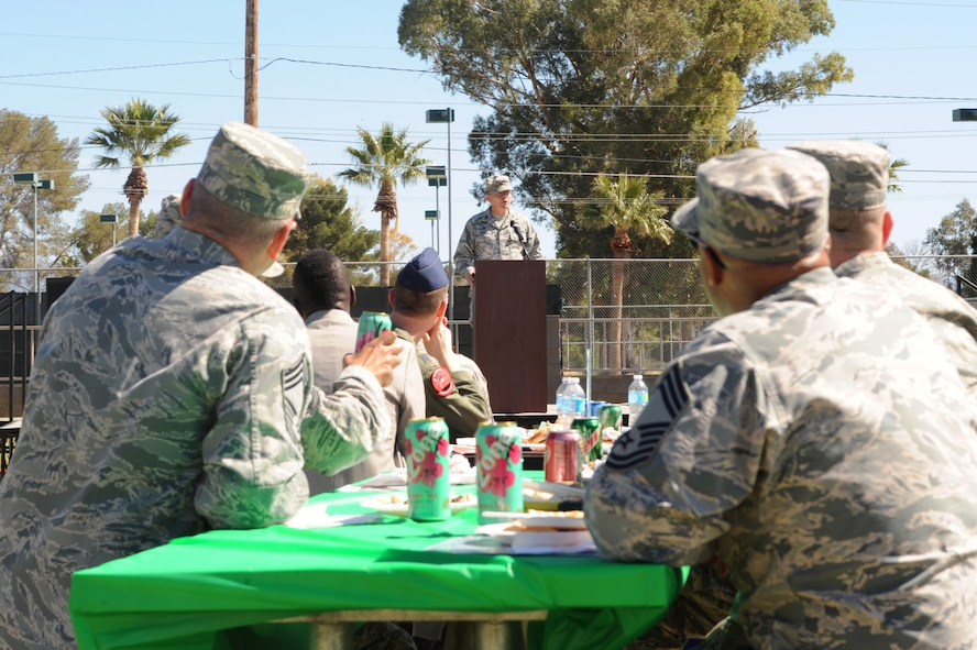 U.S. Air Force Col. Rodger Schuld, 355th Mission Support Group commander, speaks during an African American/Black History Month luncheon at Davis-Monthan Air Force Base, Ariz., Feb. 26, 2015. The luncheon was held to honor the heritage of African American and black history by coming together to enjoy food and a dance performance. (U.S. Air Force photo by Airman 1st Class Cheyenne Morigeau/Released)