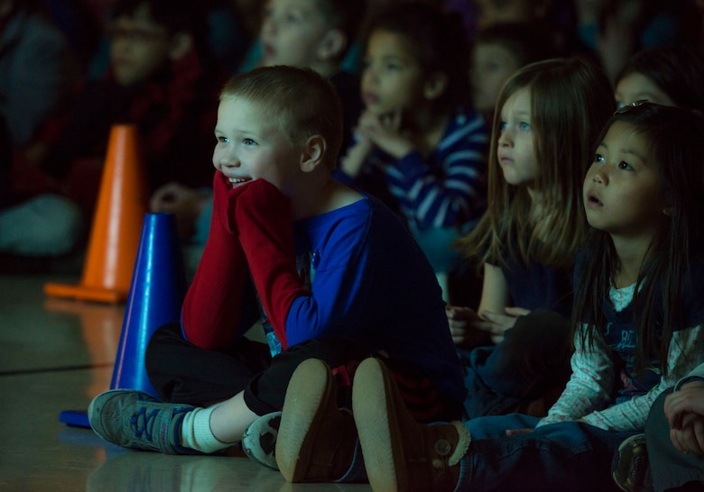 Students of Stephensen Elementary watch a video about the origin of the Chinese New Year during an assembly at Mountain Home Air Force Base, Idaho Feb. 23, 2015. The assembly focused on introducing the children to the Singaporean culture. (U.S. Air Force photo by Airman Connor J. Marth/RELEASED)