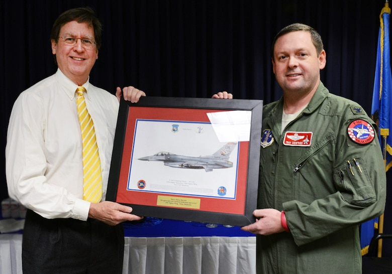 Col. Raymond Siegfried,  138th Fighter Wing vice commander presents a lithograph to Tulsa Mayor Dewey F. Bartlett, Jr. during a visit February 25, 2015 at the Tulsa Air National Guard base, Tulsa, Okla. The mayor was hosted by 138th leadership as a community outreach event aimed at fostering good relations and educating local leaders on the mission of the wing.