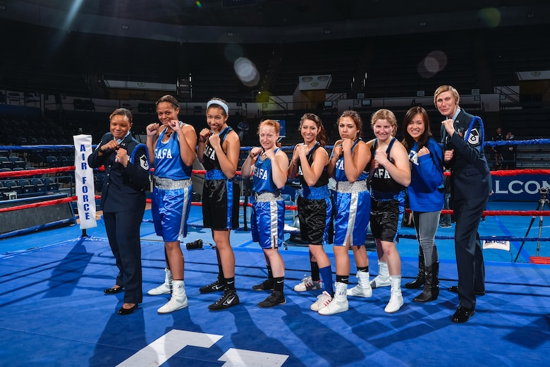 The first females to compete in the Academy's annual boxing competition, this year Feb. 19, 2015, at the Wing Open.  Left to right: Master Sgt. Sarah Allen (women's boxing club assistant coach), C4C Victoria Rodriguez, C4C Aubrey Lowe, C1C Hope Stremcha, C2C Kassie Prusko, C2C Sarenna Ortiz, C3C Bridgett Wall, C3C Heather Parcasio and Master Sgt. Debra Sheppard (women's boxing club head coach). (U.S. Air Force photo/Liz Copan)