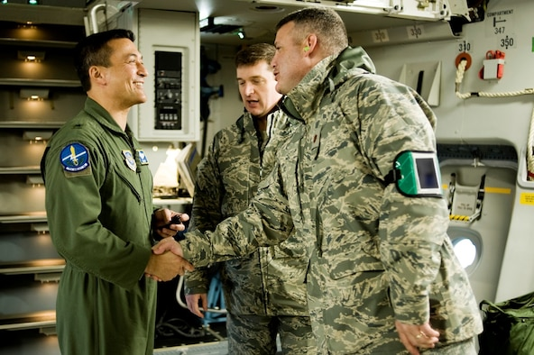 Brig. Gen. (now major general) Michael D. Kim, mobilization assistant to the Director of Operations, Headquarters Air Mobility Command, Scott Air Force Base, Ill., left, greets Maj. Christopher May, 62nd Aircraft Maintenance Squadron commander, upon arriving at McChord Field.  (U.S. Air Force File Photo/Abner Guzman)