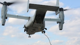 A Marine uses his newly learned helicopter rope suspension techniques while fast roping out of an MV-22B Osprey during a Fast Rope Operator Course training exercise at Stone Bay aboard Camp Lejeune, N.C., Feb. 5, 2015. Helicopters cannot always land in a landing zone and the squad must fast rope into an LZ in order to conduct operations in the area. The Fast-Rope Operators Course is a one week course that teaches Marines these needed techniques.