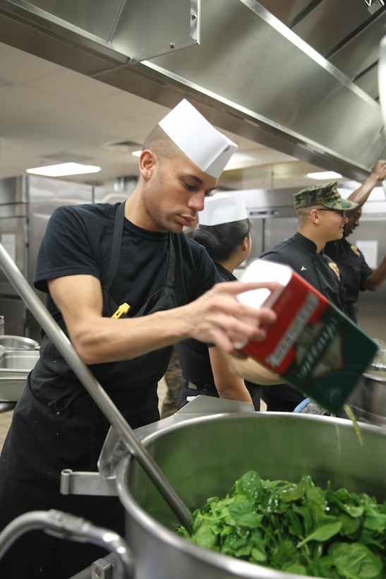 Cpl. Wesley Overholtzer prepares a meal during the mess hall's Chef of the Quarter competition at Marine Corps Air Station Cherry Point, N.C., Feb. 19, 2015. Overholtzer, a food service specialist with Headquarters and Headquarters Squadron, is a two-time winner of the quarterly competition, a native of Westminster, Md.
